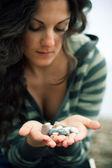 Beautiful woman holding stones — Stock Photo