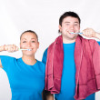 Young couple cleaning teeth together — Stock Photo