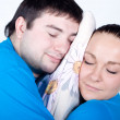 Young couple with pillow are sleeping — Stock Photo