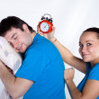 Man sleeping, woman want to wake up him - Stock Photo