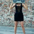 Woman with boom box head — Stock Photo #3784827