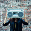 Stock Photo: Woman with boom box head