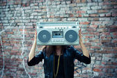 Woman with boom box head — Stock Photo