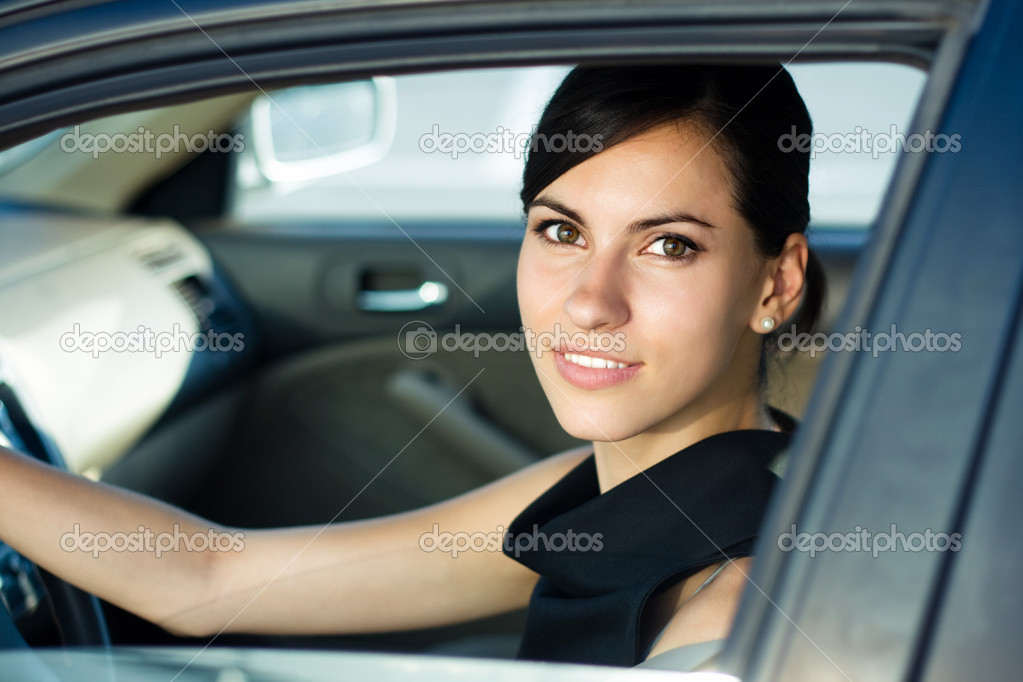 Beautiful happy woman driving her car — Stock Photo #3784866