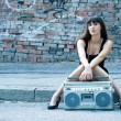 Stock Photo: Woman with boom box on the street