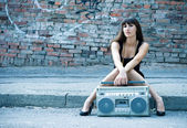 Woman with boom box on the street — Stock Photo