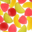 Stock Photo: Fruit candies on white background.