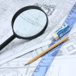 Building projects with architect drawing and protective tools — Stock Photo #2709340