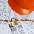 Stock Photo: Building projects with architect drawing and protective tools