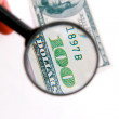 Kind of dollar through magnifying glass — Stock Photo