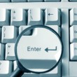 Magnifying glass on keyboard — Stock Photo #2714542