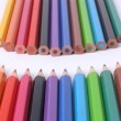 Two rows of colorful wooden crayons — Stock Photo