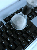 Sand-glass and keyboard — Stock Photo
