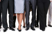 Many legs of a businesspeople — Stock Photo
