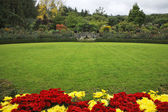 Picturesque glade in Butchard-garden — Stock Photo