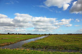 Cloudy skies and coastal plain — Stock Photo