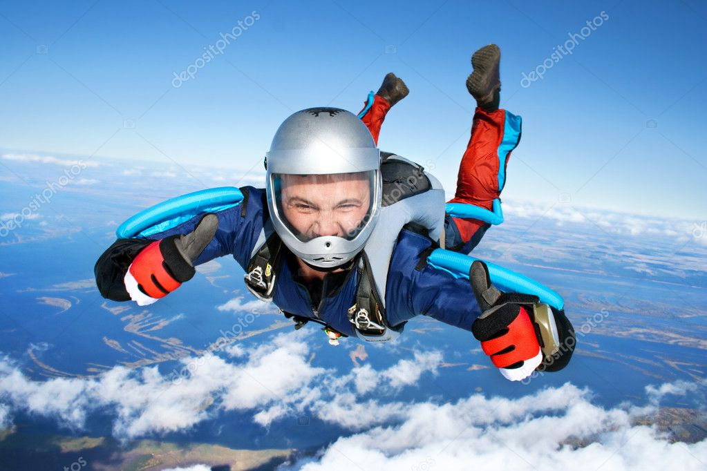 Skydiver falls through the air. All right! Thumbs up! Parachuting is fun!  Stock Photo #3574299