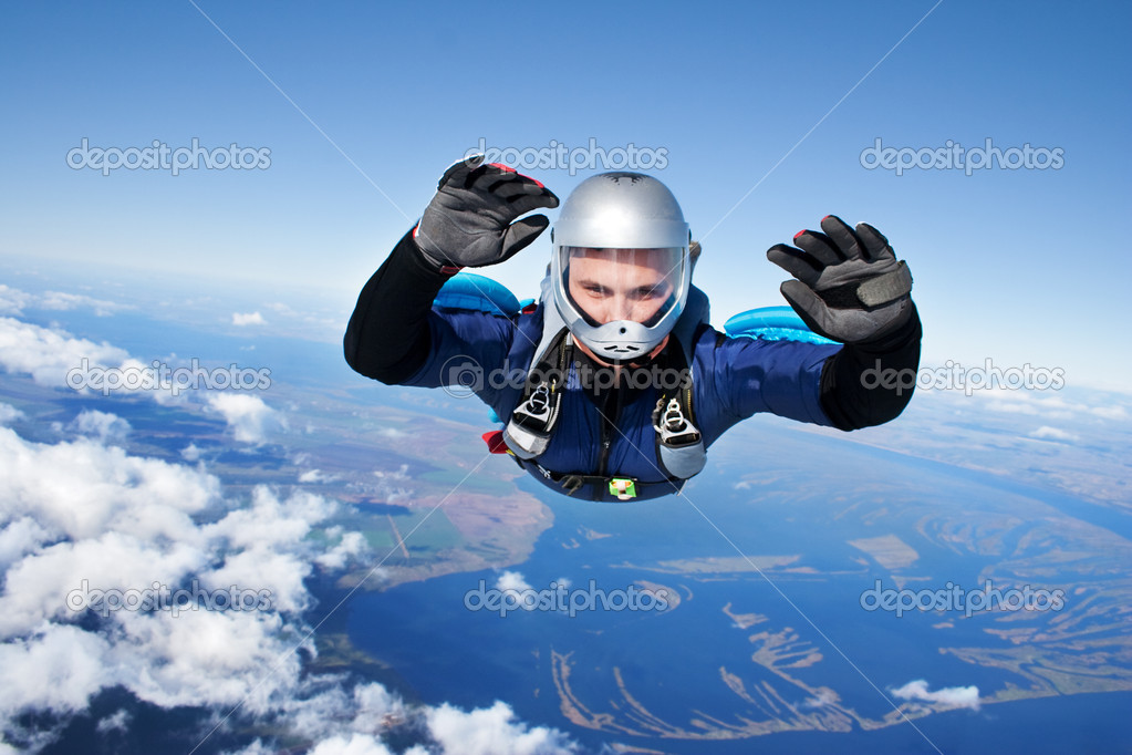 Skydiver falls through the air  Stock Photo #3574307