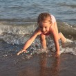 Little girl on sea beach. — Stockfoto
