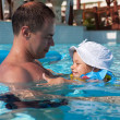 Dad with his daughter in the pool — Stock Photo