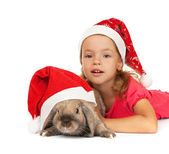 Child in the New Year hat with a rabbit. — Stock Photo