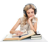 Student with books and headphones. — Stock Photo