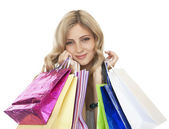 Joyful women customers with their purchases. — Stock Photo