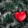 Toy in the shape of the heart and tinsel. — Stock Photo #3744290