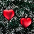 Toy in the shape of the heart and tinsel. — Stock Photo