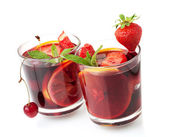 Refreshing fruit sangria in two glasses — Stock Photo