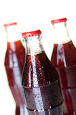 Three bottles of cold cola — Stock Photo