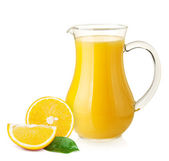 Orange juice in pitcher and oranges — Stock Photo