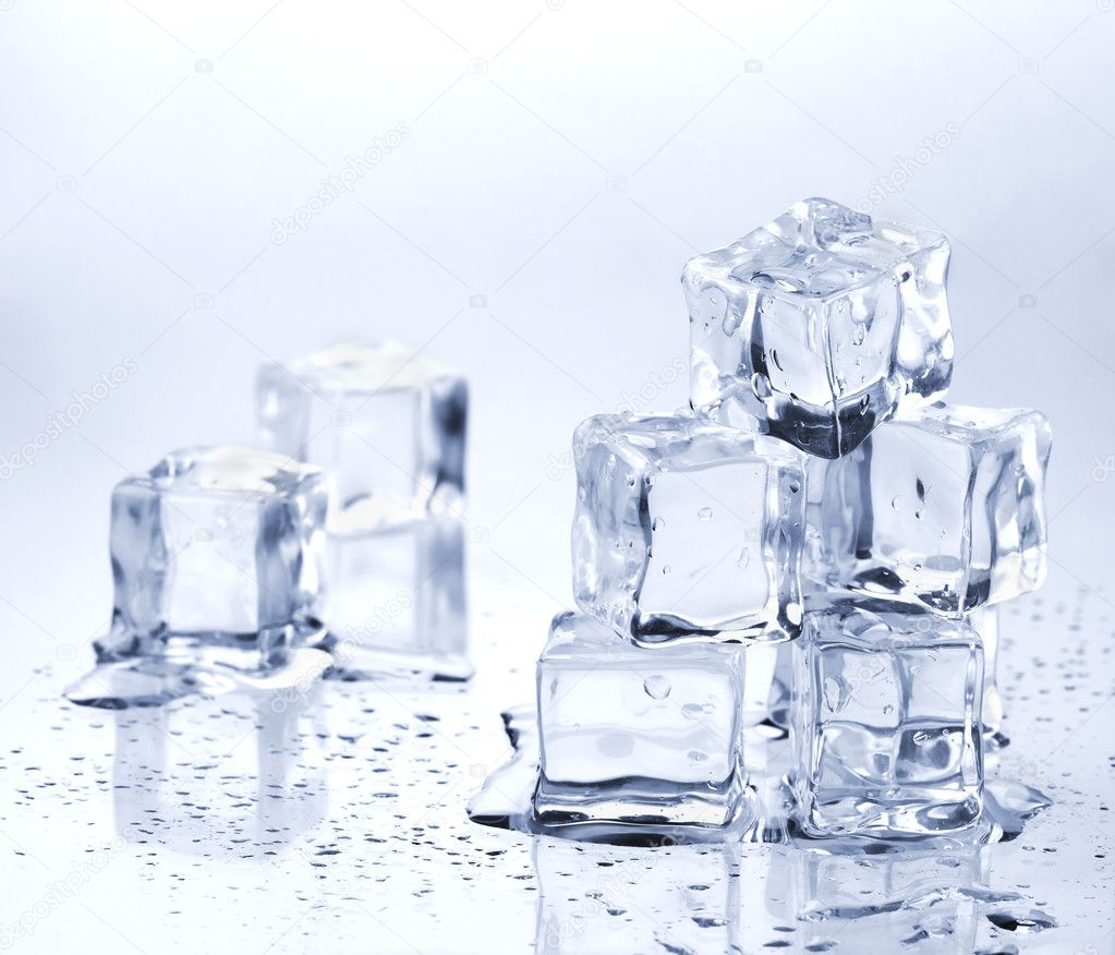 Melting ice cubes on glass table — Stock Photo #3745851