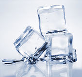 Three melting ice cubes — 图库照片