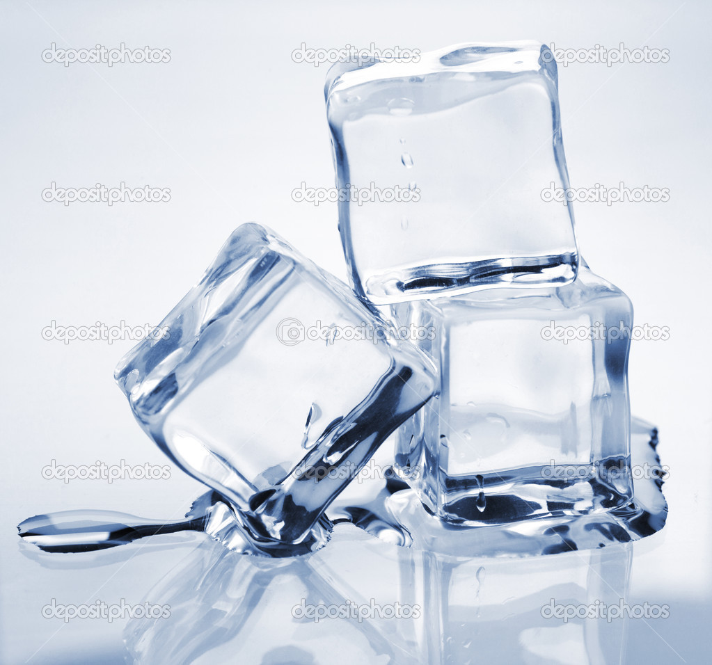 Three melting ice cubes on glass table — Stock Photo #3898680