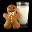 Gingerbread man with a glass of milk — Stock Photo