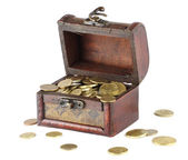 Wooden casket full of coins — Stock Photo