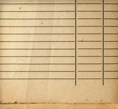 Vintage grungy lined paper closeup — Stock Photo