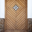 Ancient wooden door with the window - Stock Photo