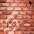 Nazi swastika on the brick wall - Stock Photo