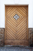Ancient wooden door with the window — Stock Photo