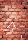 Nazi swastika on the brick wall — Stock Photo