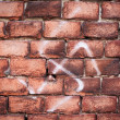 Stock Photo: Nazi swastikon brick wall