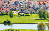 Nice private cottages beside the river — Stock Photo