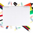 Notepad with stationary objects on white background — Stock Photo