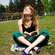 Stock Photo: Pretty young women reading book
