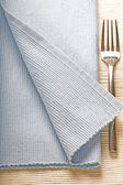 Fork on blue napkin — Stock Photo