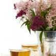 Herbal tea and flowers - Stockfoto