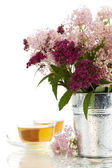 Herbal tea and flowers — Stock Photo