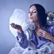 Beautifull woman stylised club fairy blowing off from palm silve — Foto Stock